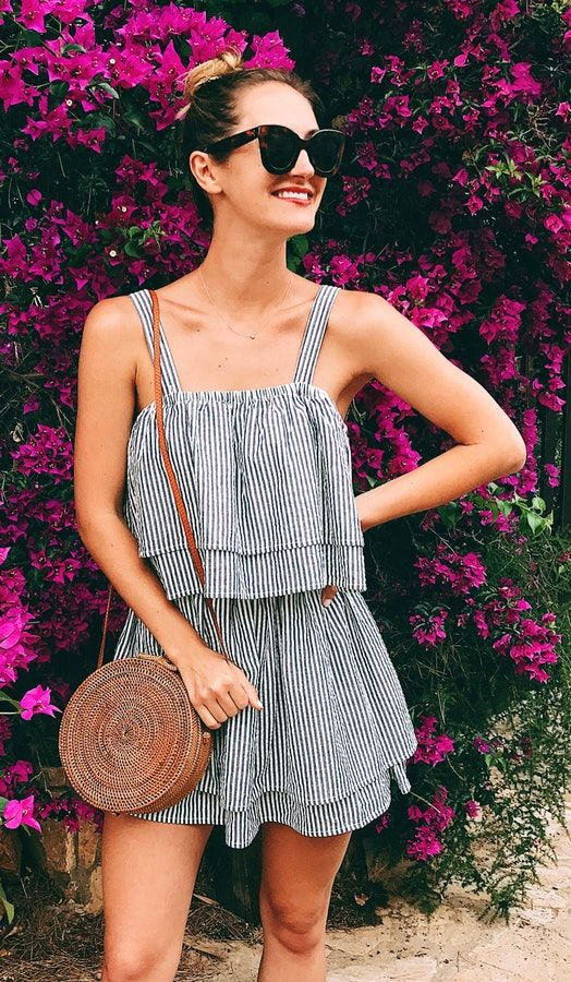 a striped black and white overall and a round wicker bag are all you need for an effortless look