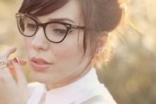 13 a black cat-eye frame is ideal for a chic retro touch