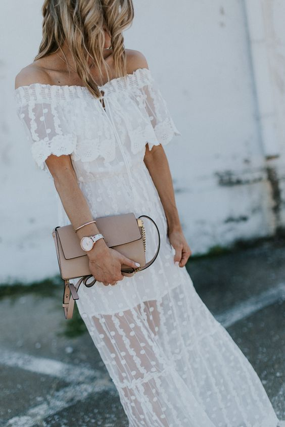a white lace off the shoulder dress with an illusion skirt, a blush bag for some special occasion