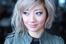 14 a wavy blonde asymmetrical bob with a black root for a deeper look