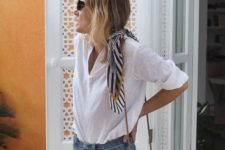14 a white shirt, blue denim shorts, a round wicker bag for a casual look