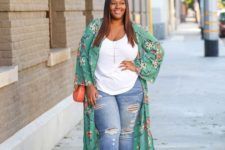 14 blue ripped jeans, a white top, a green floral kimono, orange shoes and a bag