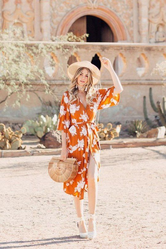 an orange wrap dress with a floral print, a straw hat, lace shoes and a cool trendy bag