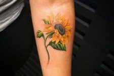 Awesome sunflower tattoo on the hand