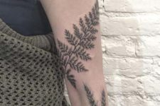 Big leaf tattoo on the arm