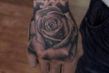 Big rose tattoo on the hand