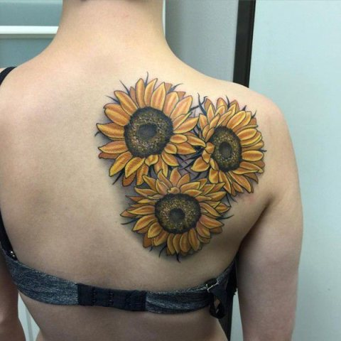 Big tattoo on the back and shoulder