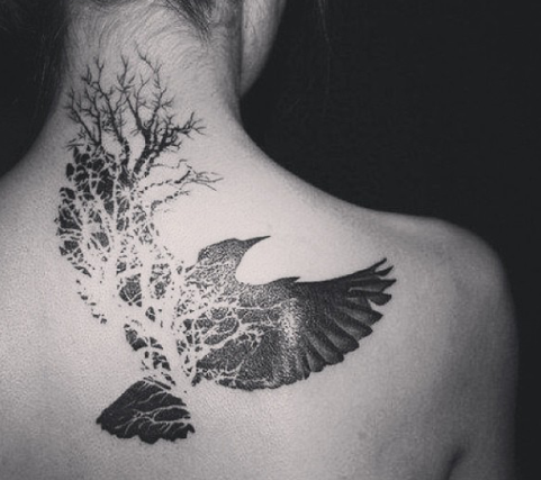 Bird and tree tattoo on the back and neck