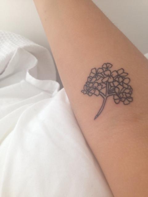 Black-contour hydrangea tattoo