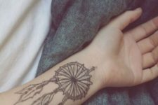 black dreamcatcher forearm tattoo