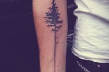 Black tree tattoo on the arm
