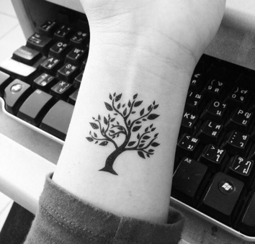 Black tree tattoo on the wrist
