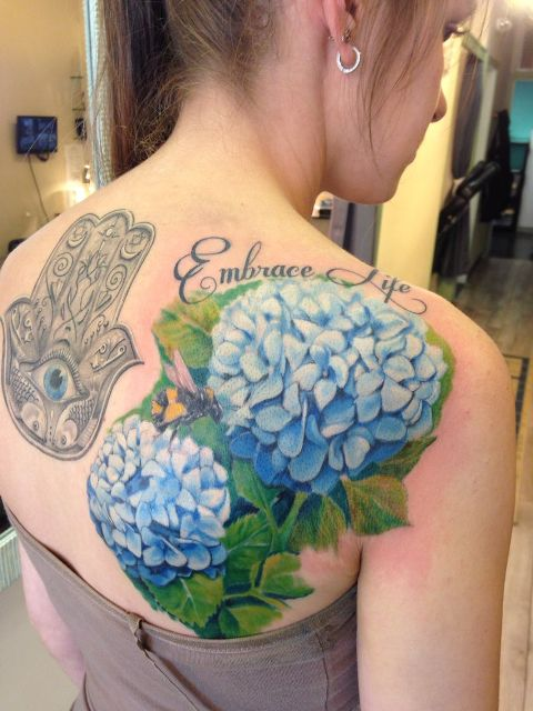 Blue hydrangea tattoo on the back and shoulder