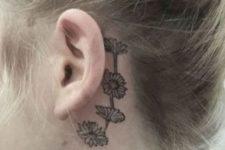 Chain daisy tattoo behind the ear