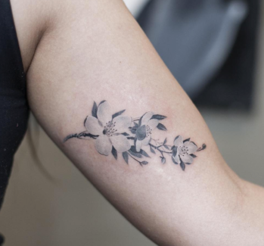 Cherry blossom tattoo design on the arm