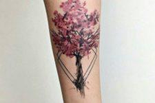 Cherry blossom tree tattoo on the forearm