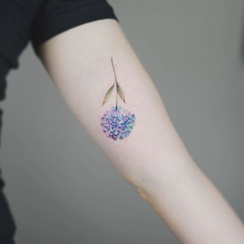 Colorful small tattoo on the arm