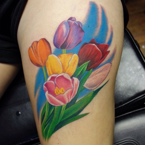 Colorful tulips tattoo on the leg