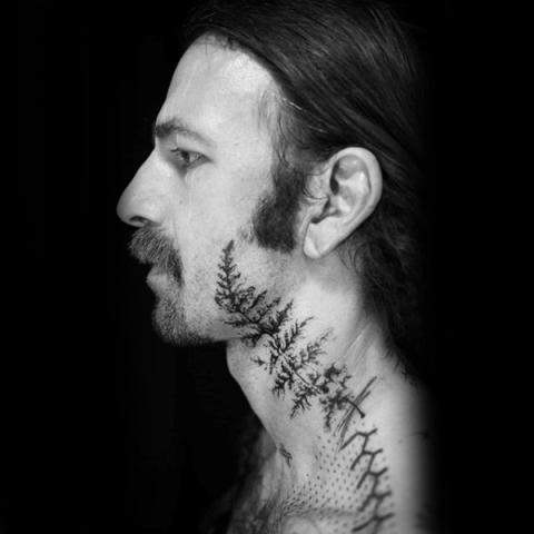 Cool tattoo on the neck and face