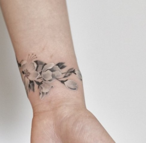 Cute cherry blossom tattoo on the wrist