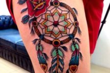 Dreamcatcher and rose tattoo on the leg
