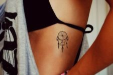 Dreamcatcher tattoo on the side