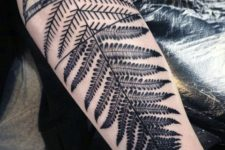 Fern and mountains tattoo on the hand