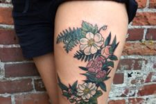 Fern with colorful flowers tattoo
