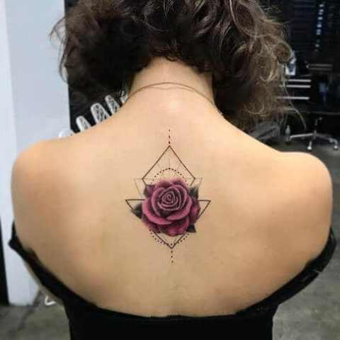 Geometric rose tattoo on the back