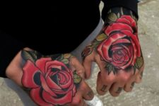 Gorgeous rose tattoos on both hands