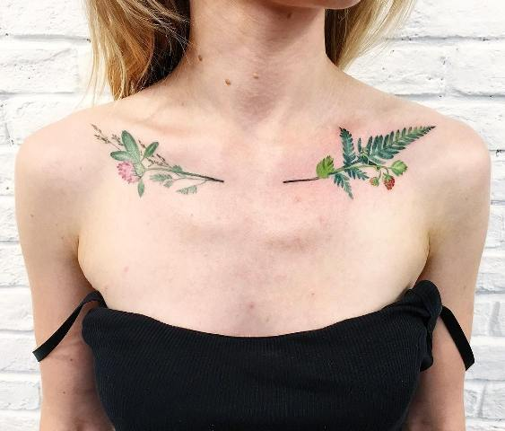 Green fern and flowers tattoo on the chest