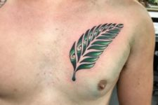Green fern tattoo on the chest