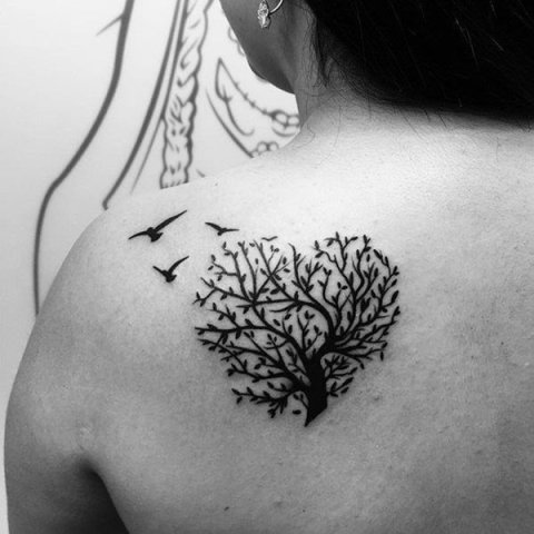 Heart shaped tree tattoo on the shoulder