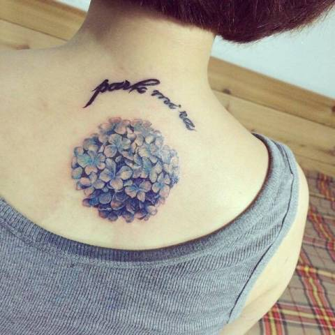 Hydrangea with phrase tattoo on the back