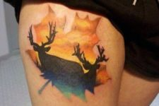 Leaf with deer image tattoo on the leg