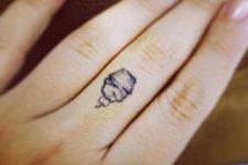 Mini cupcake tattoo on the finger