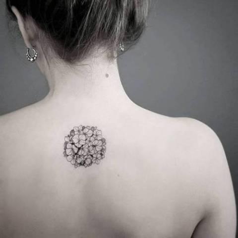 Minimalistic tattoo on the back