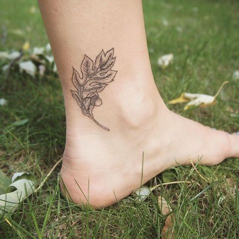 Oak leaf tattoo on the ankle