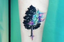 watercolor tattoo on an arm