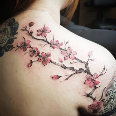 Pink and brown floral tattoo