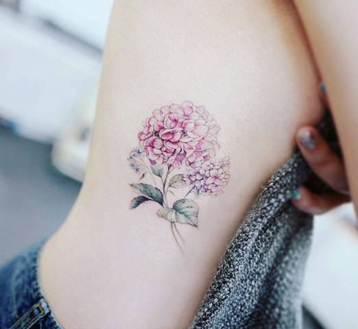 Pink hydrangea tattoo on the side