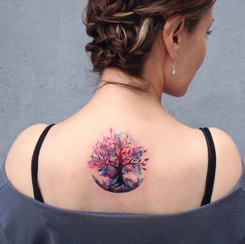 Pink, purple and lilac tree tattoo on the back