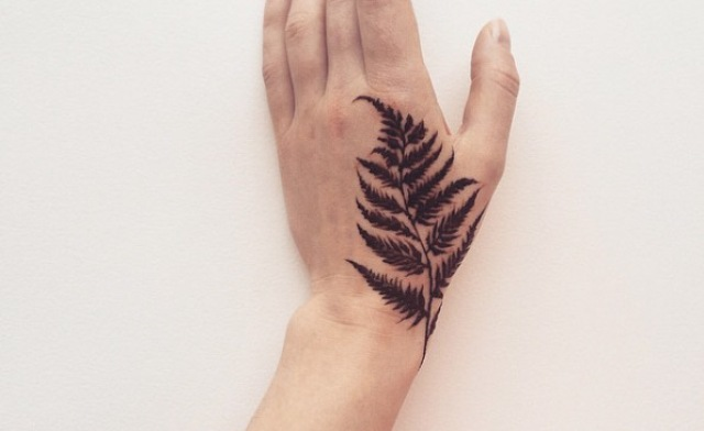 Realistic tattoo on the hand