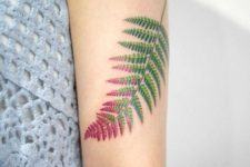 Red and green tattoo on the hand
