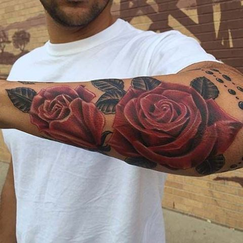 Red roses tattoo on the forearm