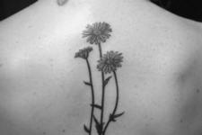 Three daisies tattoo on the back