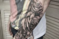 Three roses tattoo on the arm
