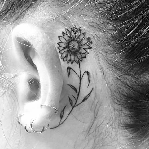 Tiny tattoo behind the ear