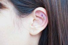 Tiny tattoo on the ear