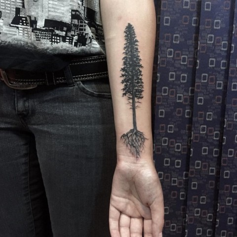 Tree tattoo on the forearm